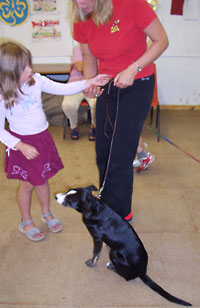Child teaching puppy